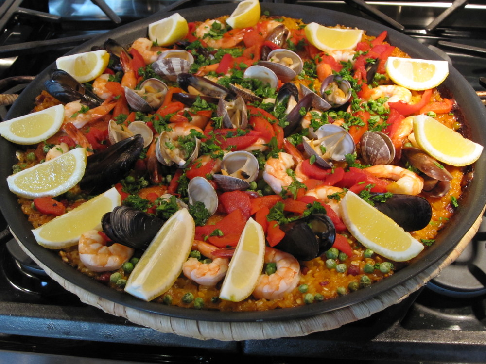 Spanish Paella with Chicken, Shrimp, Rice, Clams and Mussels