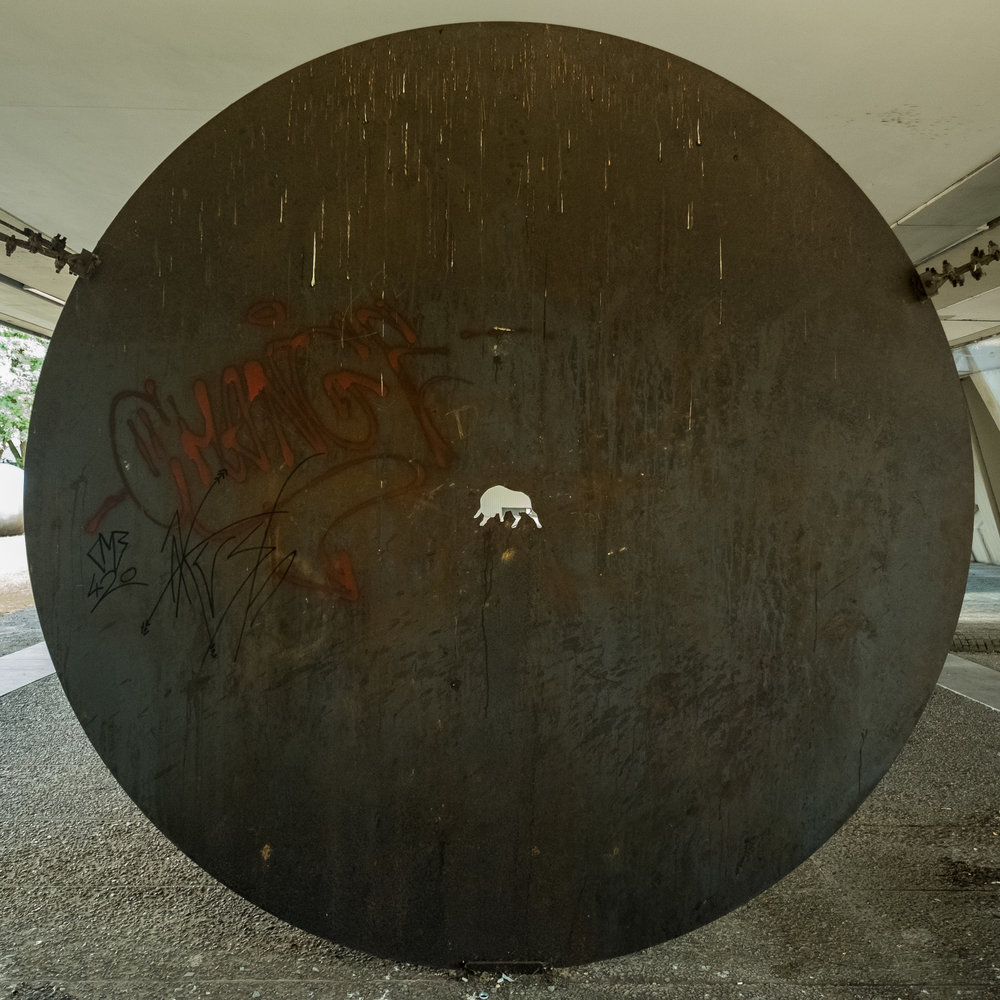 A 2m diameter metal disc, with a bull laser cut-out. Underneath the Skulpturenmuseum.