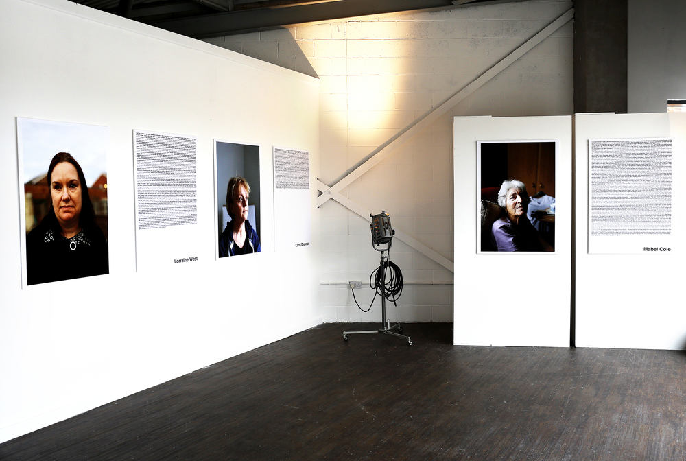 Installation photograph from the 'Women of Longbridge' exhibition.  Women of Longbridge showcases and celebrates the overlooked stories of female workers of the now closed Longbridge car factory.  The interviews document the changing attitudes towards women who worked in the male dominated environment. Covering several eras they also offer an insight into the changing approach to labour throughout the factory's life.