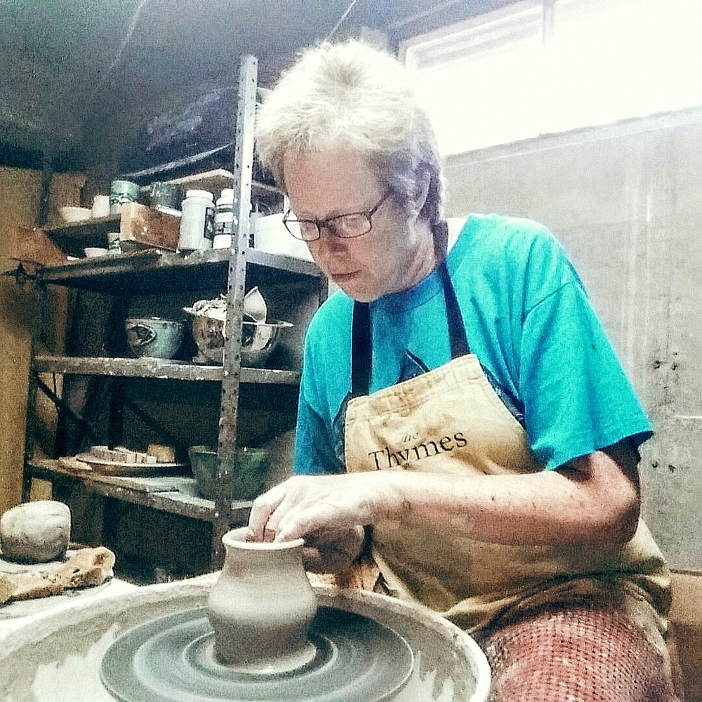 Sara Goldhawk on her very old Randall pottery wheel.