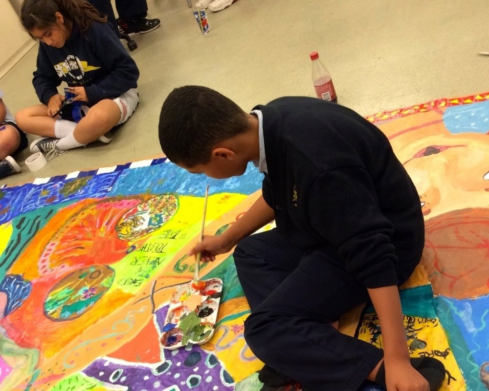 Photo: K-5 student painting mural