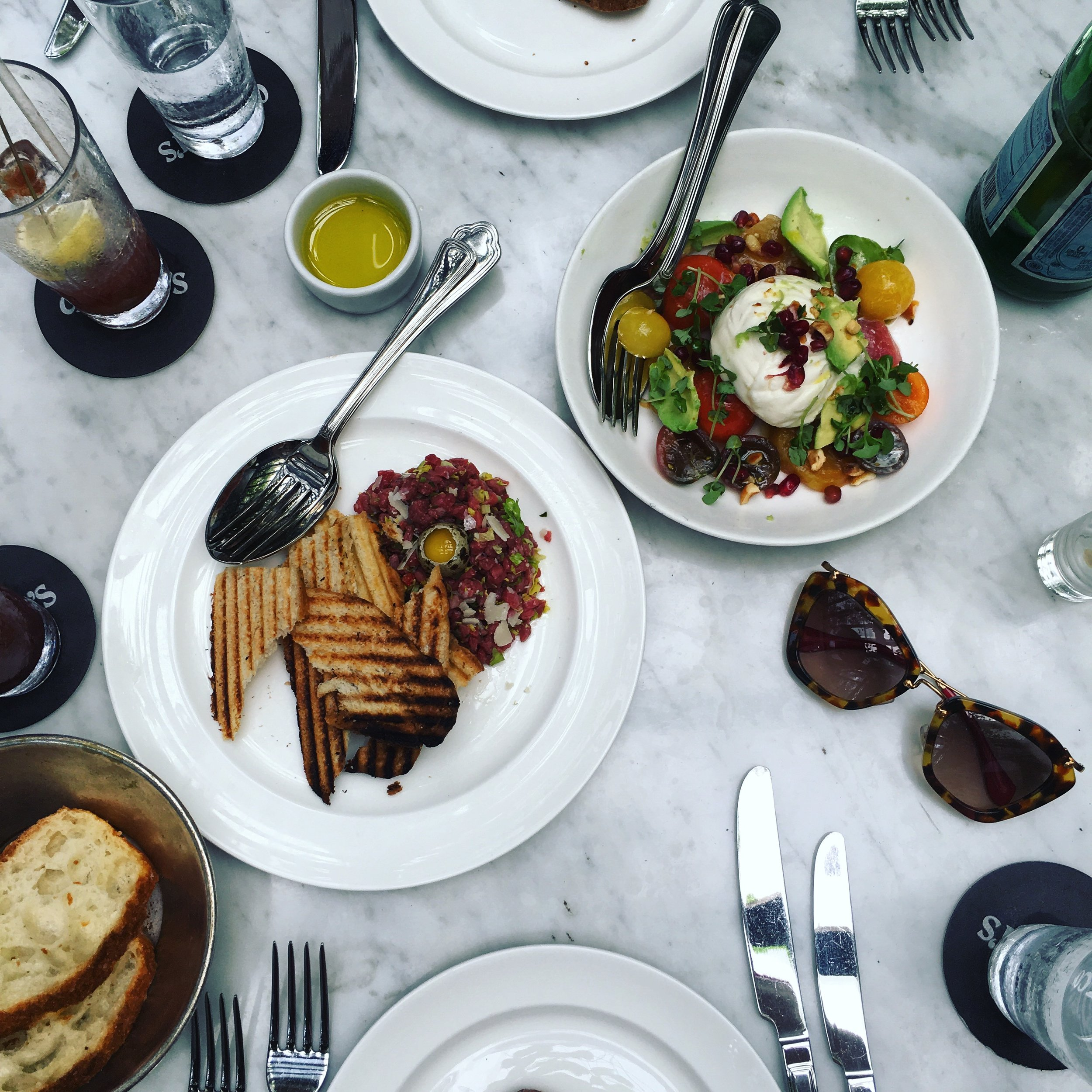 Instagrammable and delicious plates at Cecconi's Miami. Try the Burrata and Steak Tartare.