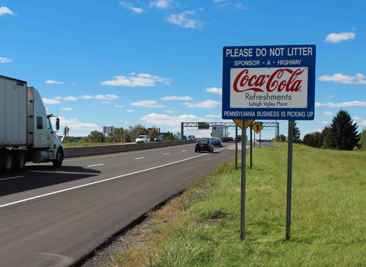 Coca-Cola Sponsor A Highway sign