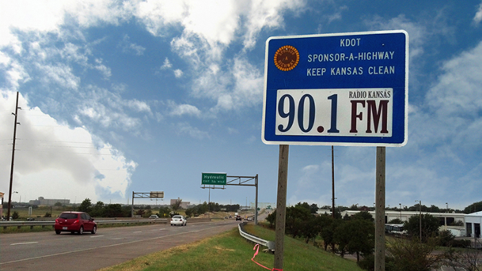 90.1 FM Sponsor A Highway sign