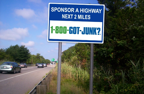 1-800-GOT-JUNK? Sponsor A Highway sign