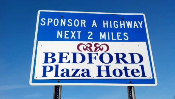 Bedford Plaza Hotel Sponsor A Highway sign