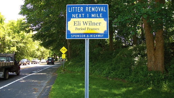 Eli Wilner Period Frams Sonsor A Highway sign