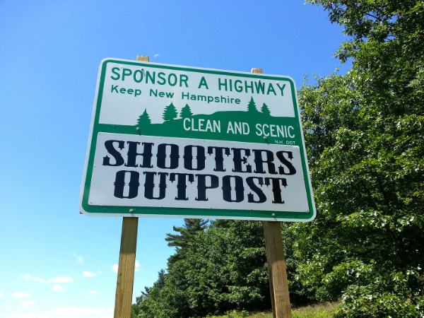 Shooters Outpost Sponsor A Highway sign