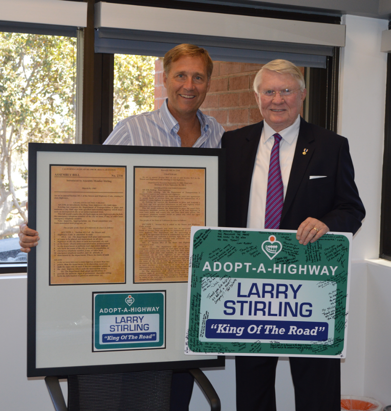 Peter Morin presents Senator Larry Stirling with a framed copy of the original Bill he authored that helped launch the Adopt A Highway ®  program.