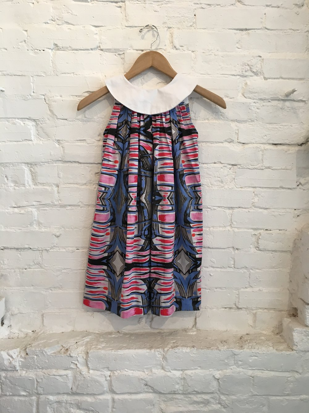 "The ""Sally"" dress, available in sizes 2T- 10.  $135"