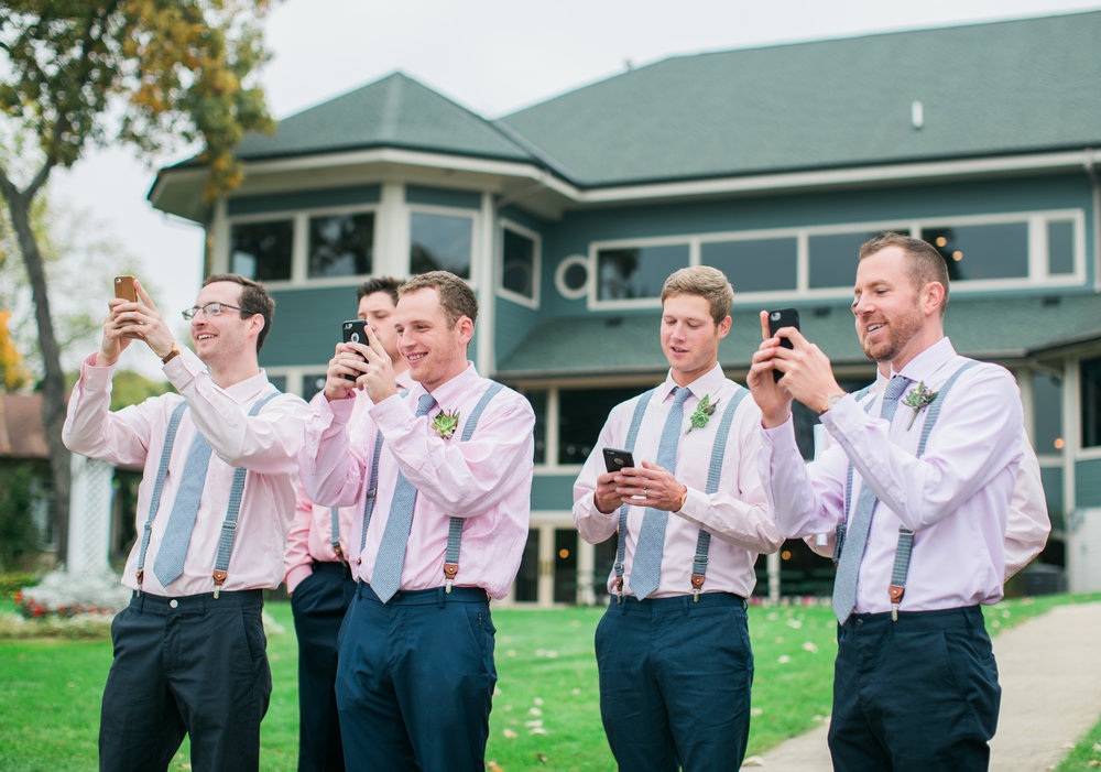As I was taking pictures of Jon, so were ALL of his grooms men. So glad my second shooter, Brittney, got this photo!