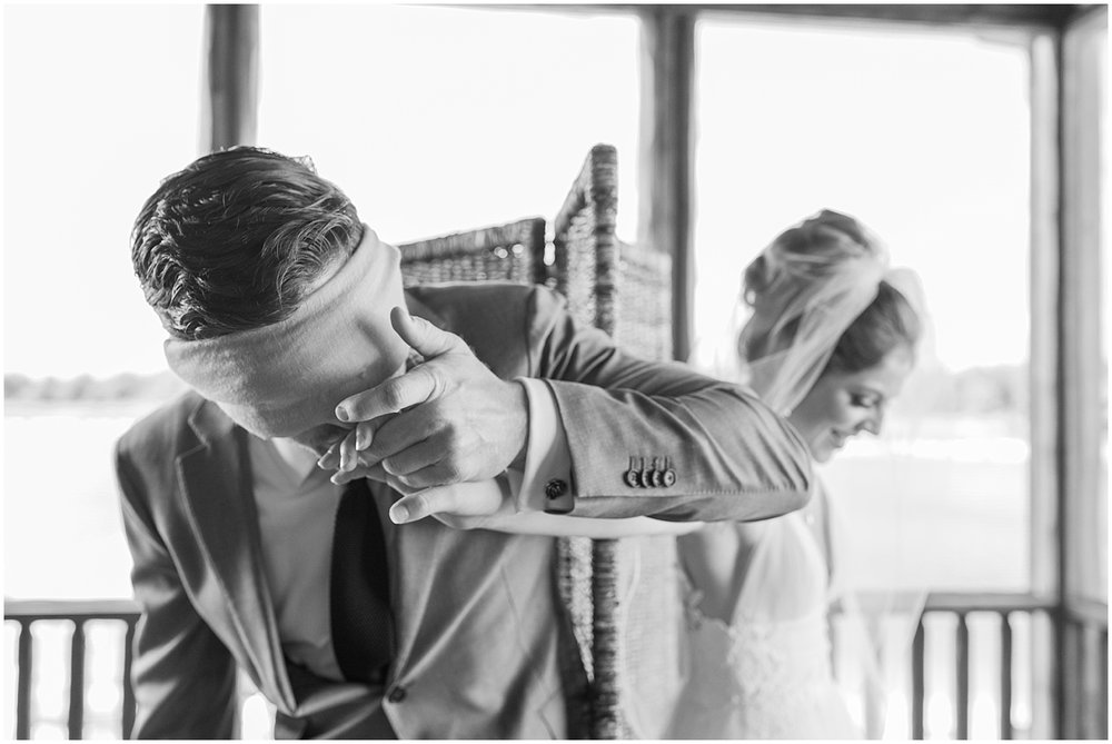 Sweet and romantic groom kissing his bride to be's hand by Alyssa Parker Photography