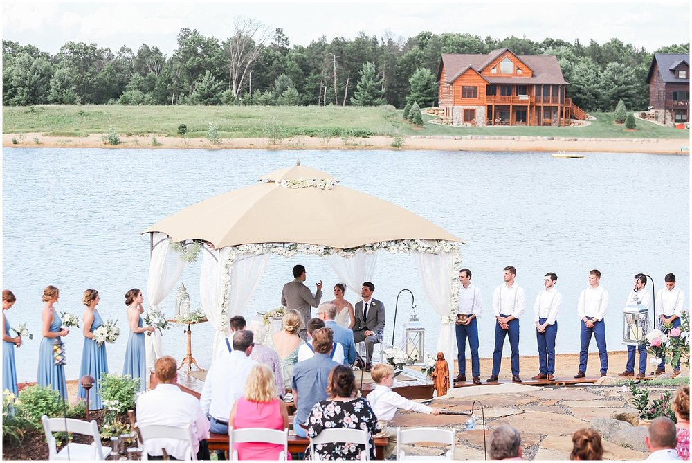 Detailed lake house ceremony on the beach by Alyssa Parker Photography