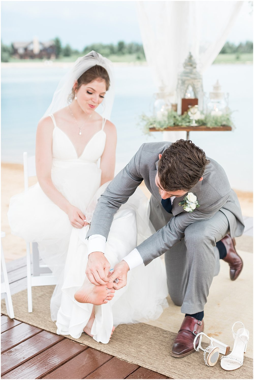 sweetest groom puts bandaid on his brides toe by Alyssa Parker Photography