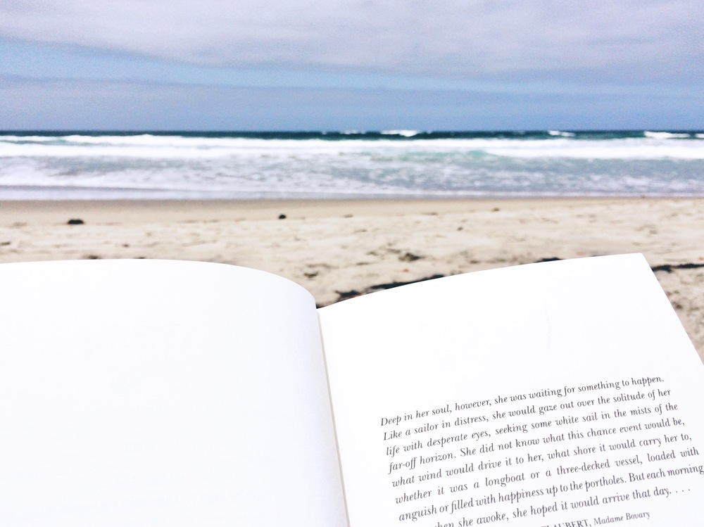 San Diego beach and book