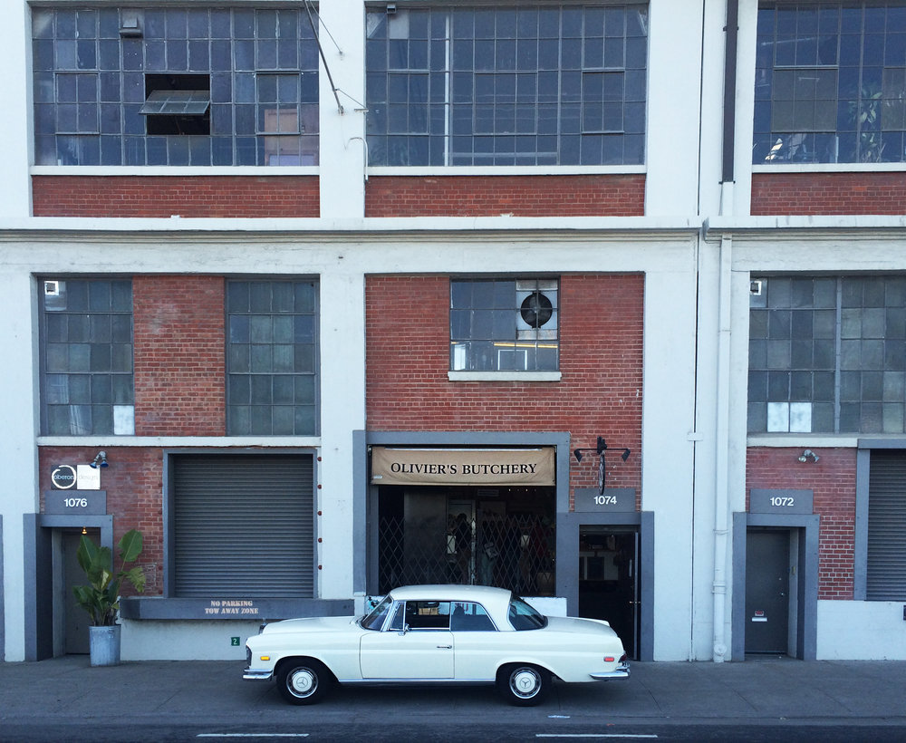 butcher shops and old cars brick building