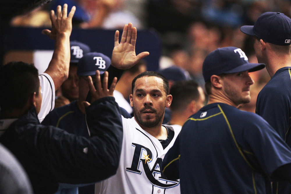 Tampa Bay Rays catcher Rene Rivera (44) scores and looks for a high-five afterwards in the sixth inning of the game between the Houston Astros and the Tampa Bay Rays in Tropicana Field in St. Petersburg, Fla. on Friday, July 10, 2015. Rivera was the first to score for the Rays.