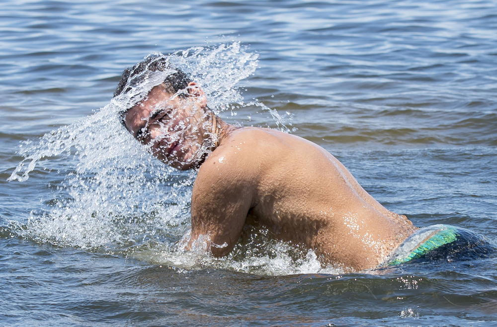 Hillsborough High School sophomore Daniel Perez, 15, shakes his head after swimming in the water at Cypress Point Park in Tampa on Monday, Aug. 17. Hillsborough County schools and Pinellas County schools started the following week.