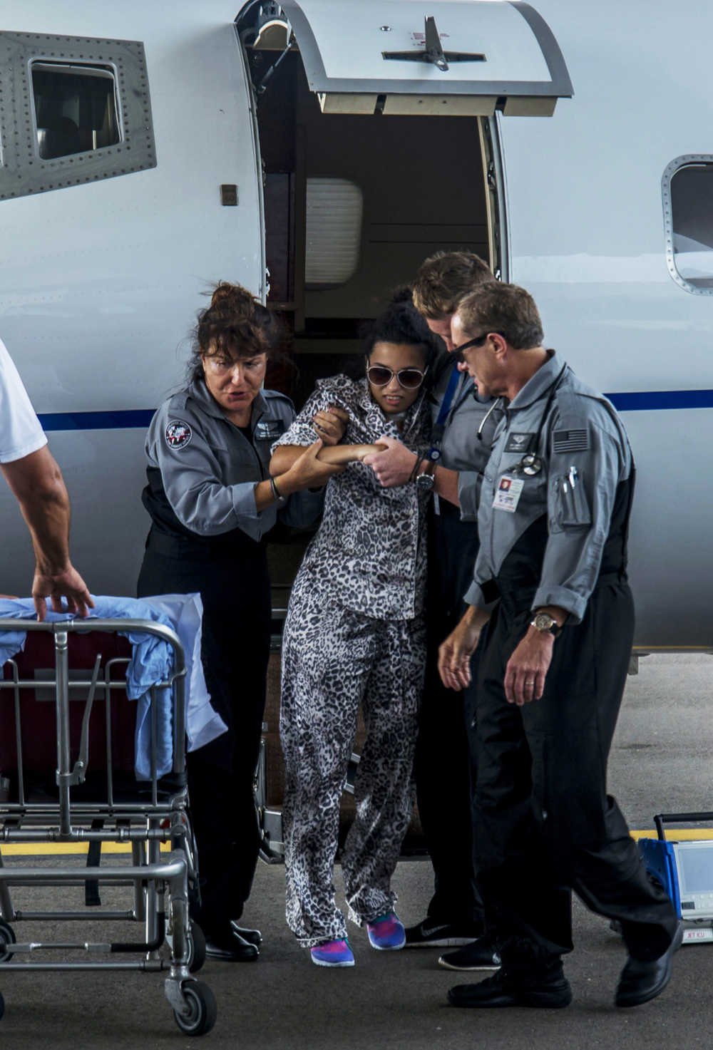 USF student Barbara Jimenez, 22, is lifted after being airlifted from Cuba to Tampa International Airport Jet Center on Friday, Aug. 28. She was stranded at a Cuban hospital after a serious automobile accident because her family's health insurance won't pay for a medical airlift. JET ICU did the airlift in a air ambulance for free.