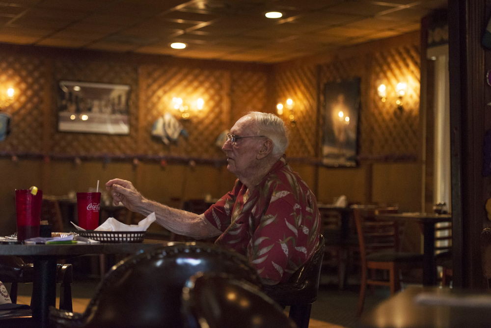World War Two veteran and Sun City Center resident John Breslin, 90, sits at the Alpha Pizza House, a restaurant in Apollo Beach. The owner, Nick Egarhos, said Breslin has gone to the establishment religiously on Tuesdays, Thursdays and Saturdays.