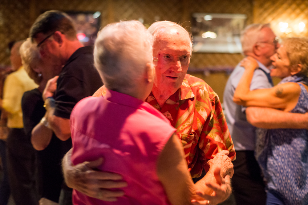 "World War Two veteran and Sun City Center resident John Breslin, 90, dances with Ruskin resident Marie Johnson. She said she has known him for years because she often comes on Tuesdays.  ""He's very good [at dancing.] The ladies all ask him, he rarely sits down,"" Johnson said."