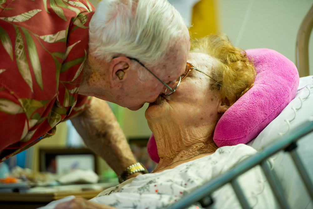 "John Breslin, 90, kisses his wife, Rita Breslin, 87, goodbye at Palm Gardens Nursing Home in Sun City Center on Tuesday, Aug. 18. Rita lost her legs to Peripheral Arterial Disease. John visits her every day, twice. ""As far as I'm concerned she's my whole life,"" Breslin said."