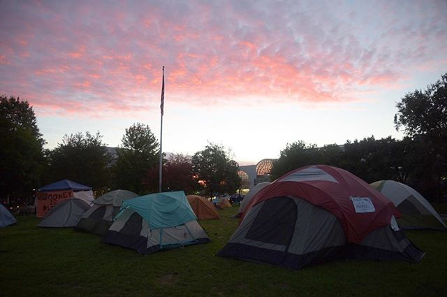 Dawn rises on DivestNU tents in Centennial Common on Wednesday, Oct. 12. DivestNU is dedicated to getting Northeastern University to divert investments in fossil fuels, and have been protesting in Centennial for over a week. #northeastern #divest