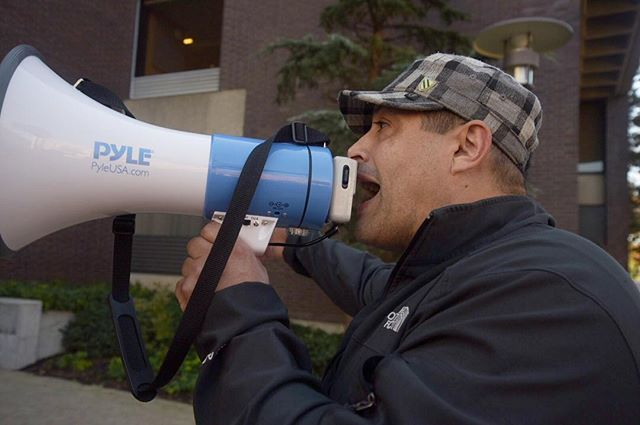 "Emmanuel Amarao, Harvard employee for 22 years, chants into a megaphone at the Harvard food workers strike on Wednesday, Oct. 12. The strike was organized last week because their new contracts would make them pay for a larger portion of their health care plan. ""Harvard is just being cheap to us,"" he said. #harvardstrike #harvard #strike"