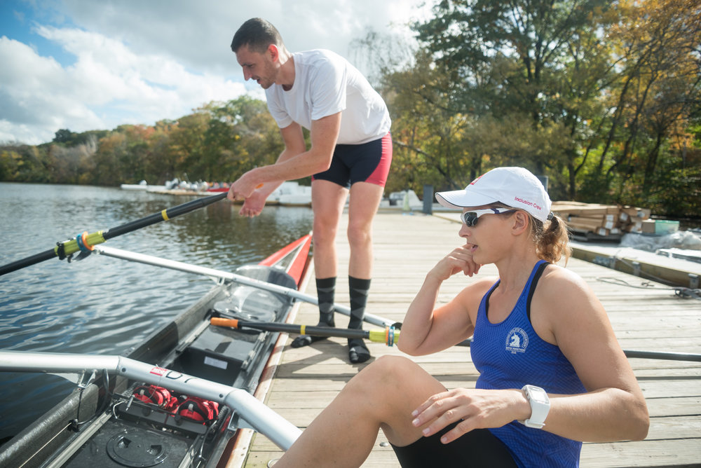 "Matt Wheeler, left, and para-rower Johanna Beyer, right, prepare to launch during their practice on Friday, Oct. 21. Wheeler is a three-time U.S. national team member who has competed in 11 Head of the Charles Regattas. Wheeler also said that Beth Noll, CRI coach and coach of the para-advisory committee at the Head of the Charles, contacted him about rowing in the inclusion event.  ""There's not much difference between Olympians and Para-Olympians. They both are the best athletes in the world,"" Wheeler said. ""[Beyer's] a really good athlete. I'm lucky I got her."""