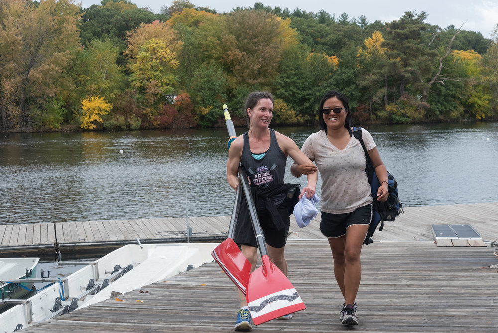 "Corree Naslund, right, 32, guides Natalie McCarthy, 29, after their practice on Friday, Oct. 21. Naslund is the coxswain for McCarthy's inclusion fours team. Naslund has been coaching rowing for 10 years.  ""We have the benefit of being in Boston. We get a lot of draw and support for para-athletes,"" she said. ""I just see [inclusion] as another facet of rowing, another opportunity athletes have for competing.""  McCarthy has been blind since she was 11 because of a brain tumor. She said she's familiar with the usefulness of inclusion.  ""I started rowing in college on an able-bodied team. I've been rowing in inclusion programs throughout my rowing career,"" McCarthy said."
