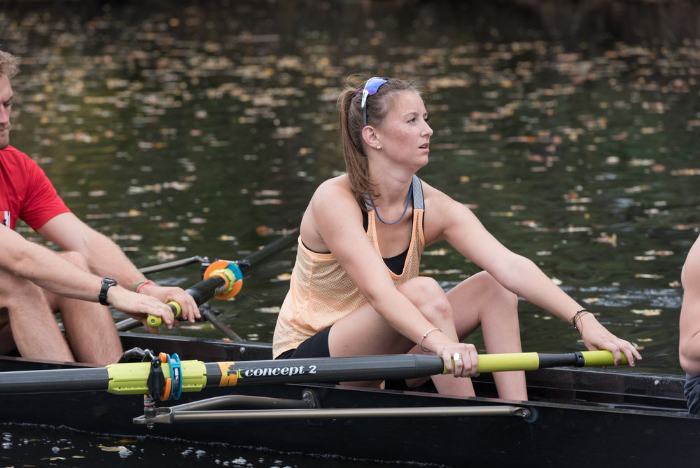 "Kate Barrett, 24, rows during practice on the Charles River on Friday, Oct. 12. She lost most of the use in her legs due to a skiing accident in Spain. Through physical therapy, she has been able to regain some control.  Finding physical therapy to be repetitive, Barrett looked for a new way to stay active and looked to rowing.  ""The sport wasn't limited by my limited mobility,"" she said. ""I get to leave the crutches behind on the dock.""  She said being paired with world-class athletes push her and other para-rowers to ""another level."" In addition, she said that inclusion events help with social progress regarding the perception of para-athletes.  ""It helps to break down the barriers between para-athletes and regular athletes. Everyone is just an athlete,"" Barrett said."
