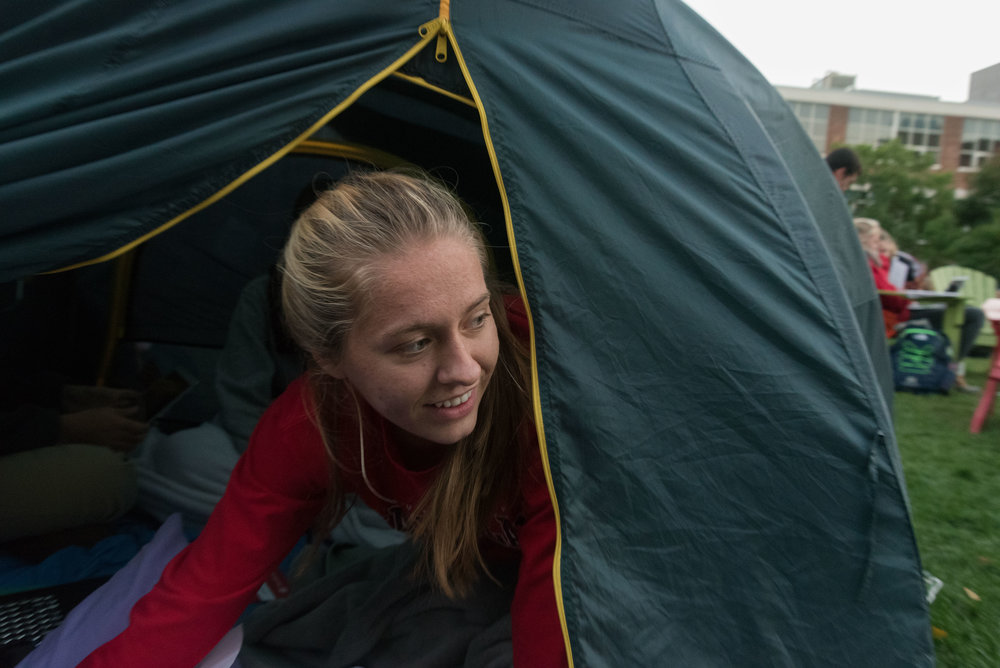 DivestNU member and freshman Brianna Brazee pokes her head out of a tent on Centennial Common on Tuesday, Oct. 4, 2016. At 6 p.m. that evening DivestNU conducted a rally on Centennial.