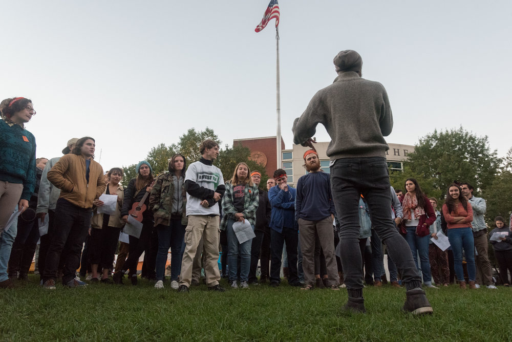 DivestNU co-founder and senior Austin Williams speaks to the crowd during a rally on Centennial Common on Tuesday, Oct. 4, 2016. The rally consisted of various chants, as well as musical presentations from other members targeted at Northeastern's refusal to divest.
