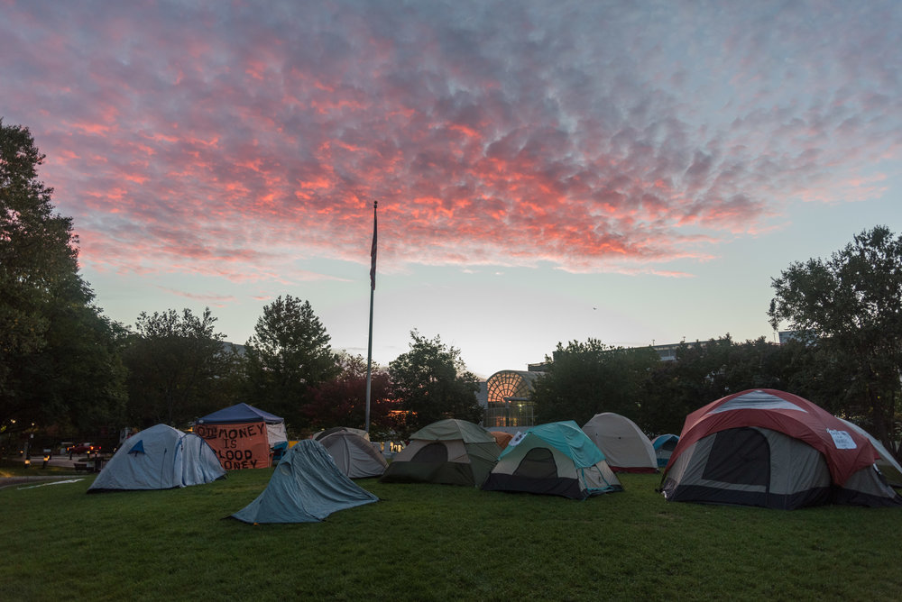 Dawn rises on DivestNU tents on Centennial Common on Wednesday, Oct. 12, 2016. DivestNU is dedicated to getting Northeastern University to divert investments in fossil fuels and had been protesting in Centennial for over a week. The temperature was 45 degrees at sunrise.