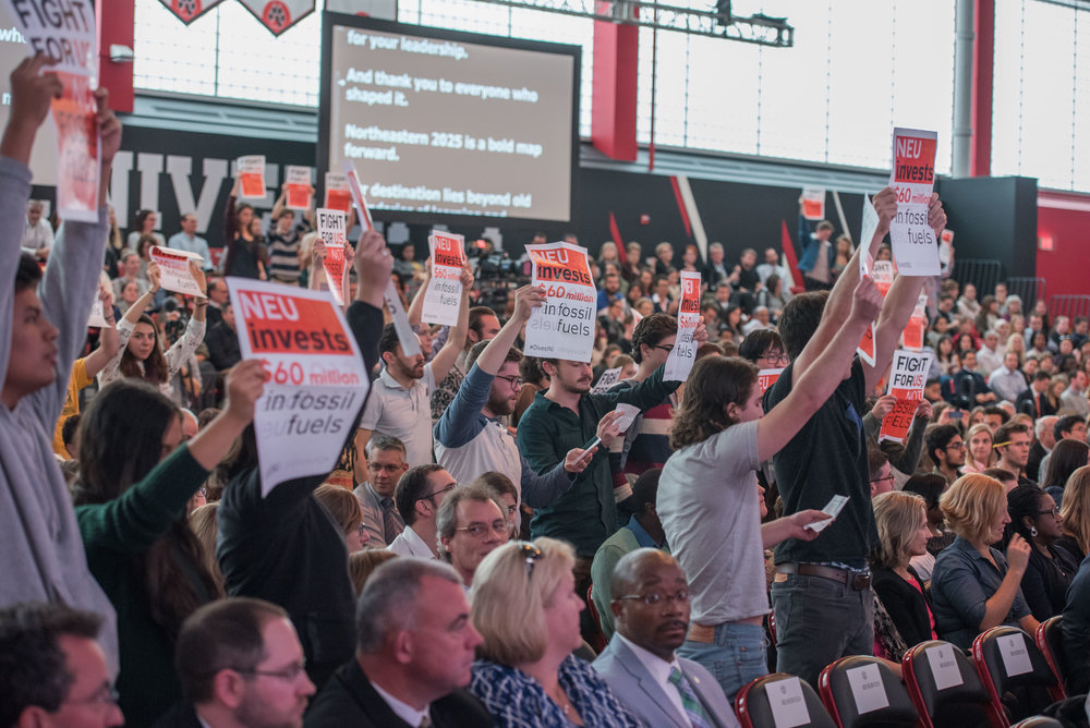"DivestNU members disrupt the 2016 State of the University on Thursday, Oct. 20.  ""Today you will tell us that Northeastern is a leader in sustainability, while you continue funding climate change,"" the students chanted."