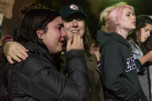 "Emerson College juniors Samone Torn, left, sobs while Christina Sargent consoles her during an anti-Trump rally on Boston Common on Wednesday, Nov. 9. Thousands marched around the Common and to the State House during the event, put on by the group Socialist Alternative, to protest the election of Donald Trump. ""(I wanted) to be with a group of people who choose love over hate,"" Torn said. #boston #protest #news"