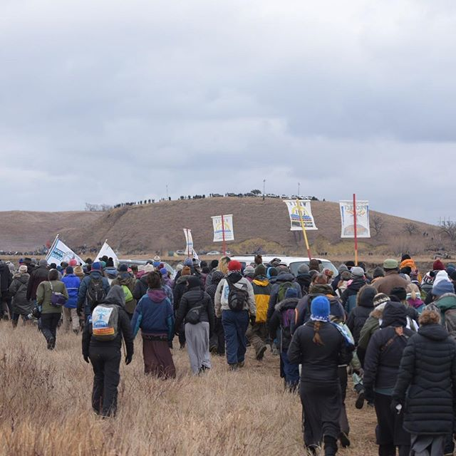 Water protectors from the Oceti Sakowin Camp in North Dakota march toward Turtle Island on Thursday, Nov. 24, where they said the Dakota Access Pipeline will threaten not only their water supply but an alleged burial site on the island. The $3.8 billion pipeline, being constructed by Energy Transfer Partners, has been the subject of intense, several-month-long protest.