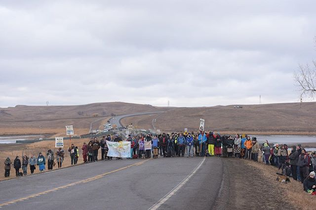 Water protectors stand in front of Backwater Bridge in North Dakota before a prayer ceremony on Thursday, Nov. 24. The bridge has been the site of quarrels between police and protestors, who are opposing the construction of the Dakota Access Pipeline, which they say threatens the water supply for the Standing Rock Sioux Tribe. #standingrock #dakotaaccesspipeline #waterprotectors