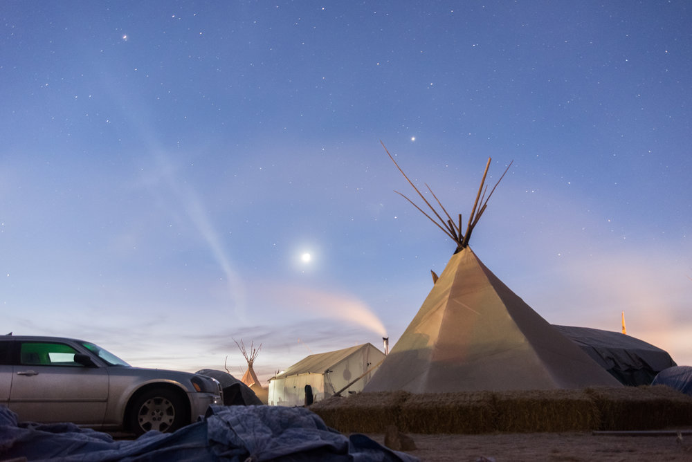 CANNON BALL, North Dakota — Stars fade in the early morning in Oceti Sakowin on Saturday, Nov. 26.