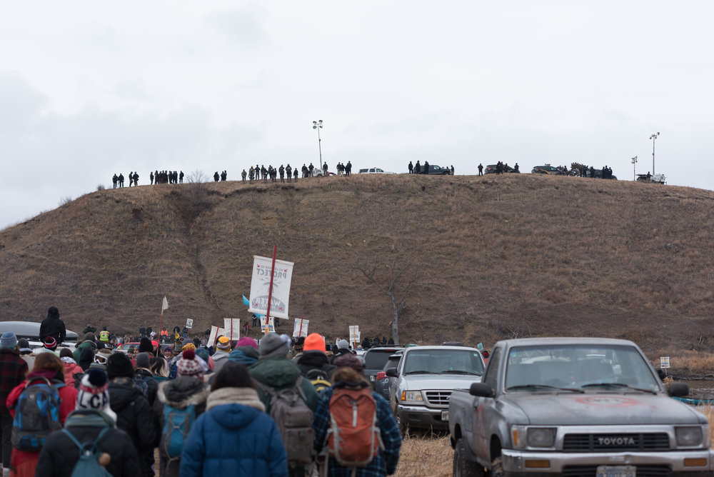 CANNON BALL, North Dakota — Water protectors march from Oceti Sakowin to Turtle Island to help other protesters on Thursday, Nov. 24. Standing Rock Sioux say that Turtle Island is a a sacred burial ground and part of the Dakota Access Pipeline is scheduled to be built on it.
