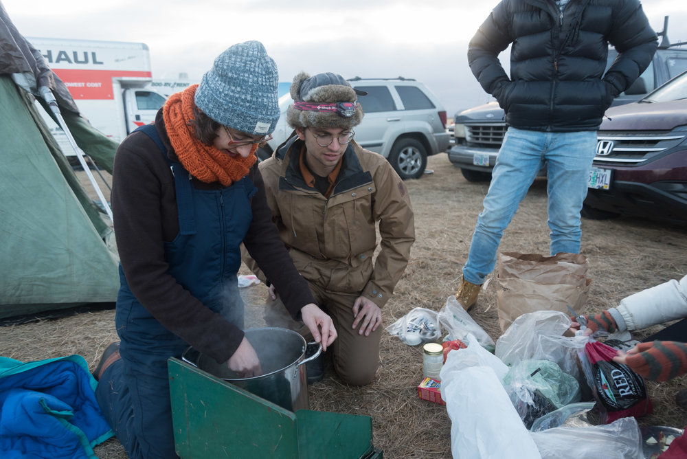 CANNON BALL, North Dakota — Northeastern University students cook soup for dinner on Thursday, Nov. 24. The students travelled over 32 hours by van from Boston, Massachusetts and gave up their Thanksgiving break to protest with other water protectors.