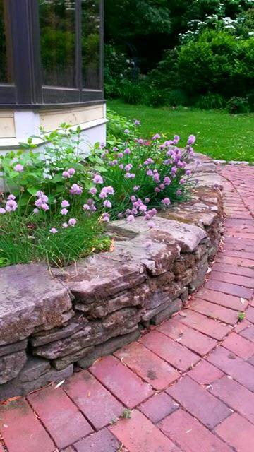 Fieldstone Wall built to create space for herb garden