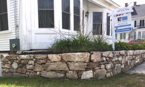 Fieldstone Veneer added to existing Concrete Wall