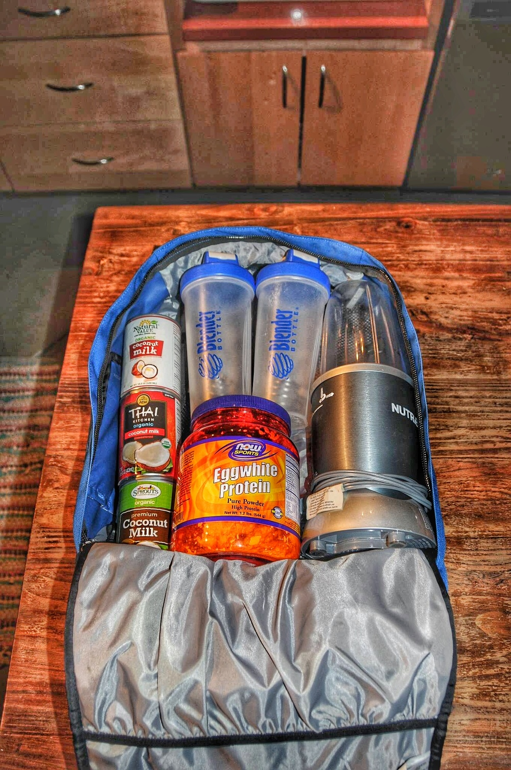 Getting our bags packed for a road trip- blender bottles, nutribullet, coconut milk and protein powder