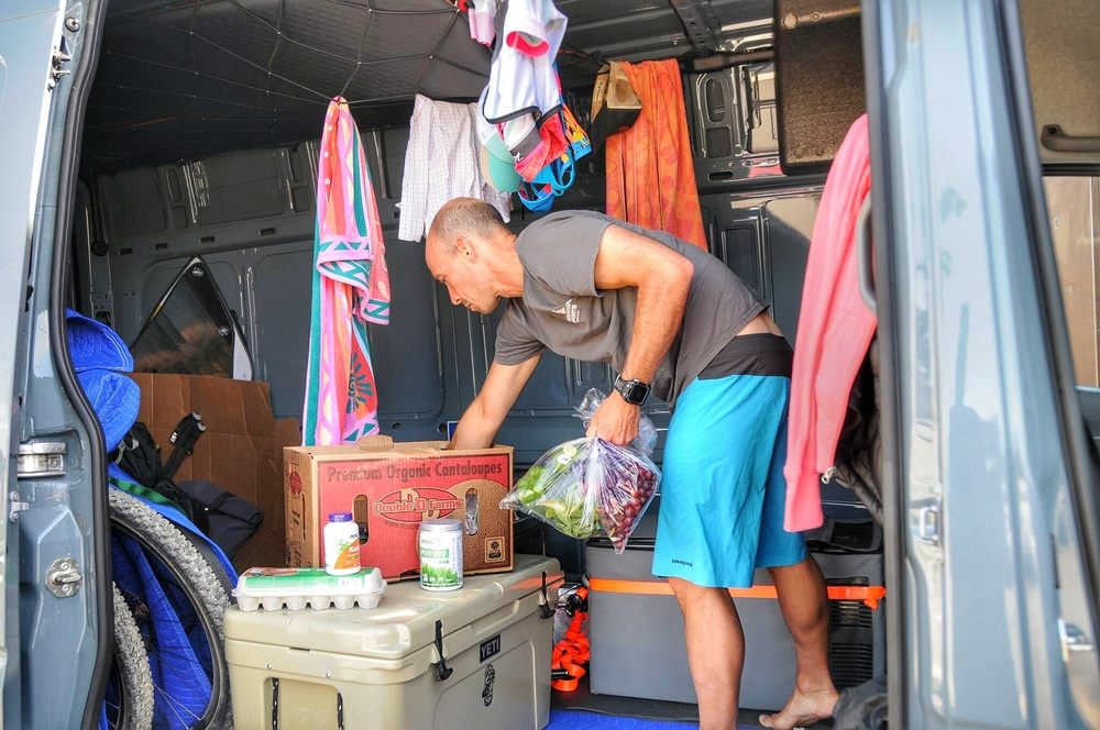 After getting our home-on-wheels clean, it was time to stock up on groceries. Here Matt is restocking the coolers with fresh produce.