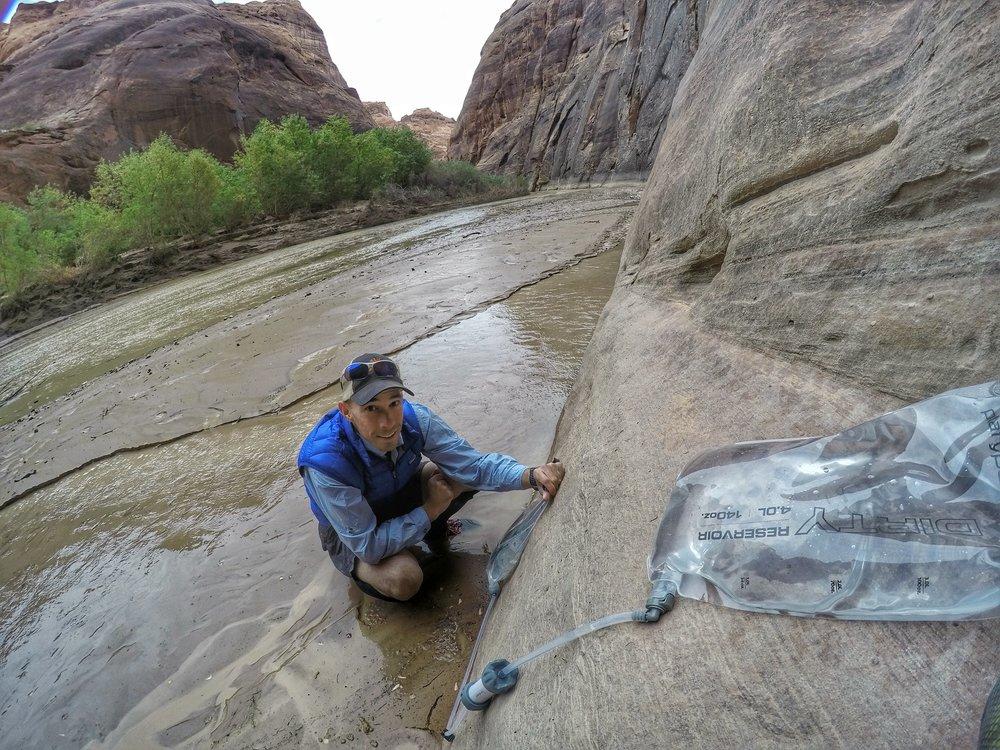 An up-close look of Matt filtering water