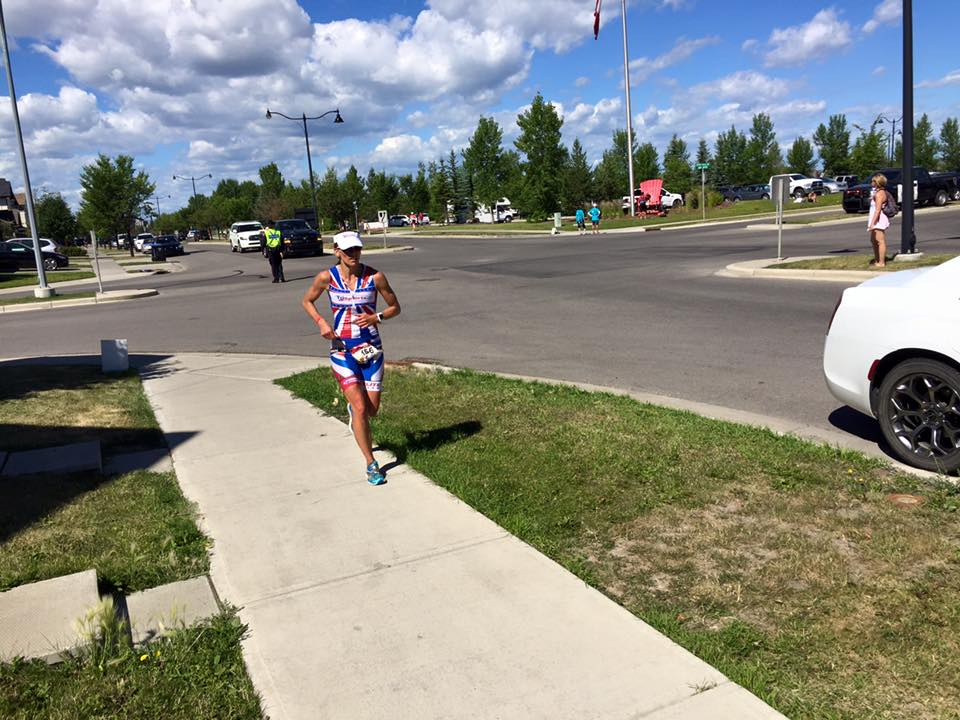 "This is me at Calgary 70.3 asking EVERYone I pass ""Where in the hell is the finish line?"" I thought I just had to turn the corner and there it would be as we were already back at the lake and the transition area, but I didn't see any finish line and I'd already been ""kicking"" for about 3/4 of a mile. Unfortunately for me, the finish line was still another half mile down the road. Ughhh!!!"