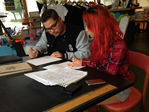 Our students love to help each other! Danny offered his expertise to help Crystal work on her professional portfolio #youthinteractive #portfolio #art #nonprofit #mentor #entrepreneurship #santabarbara