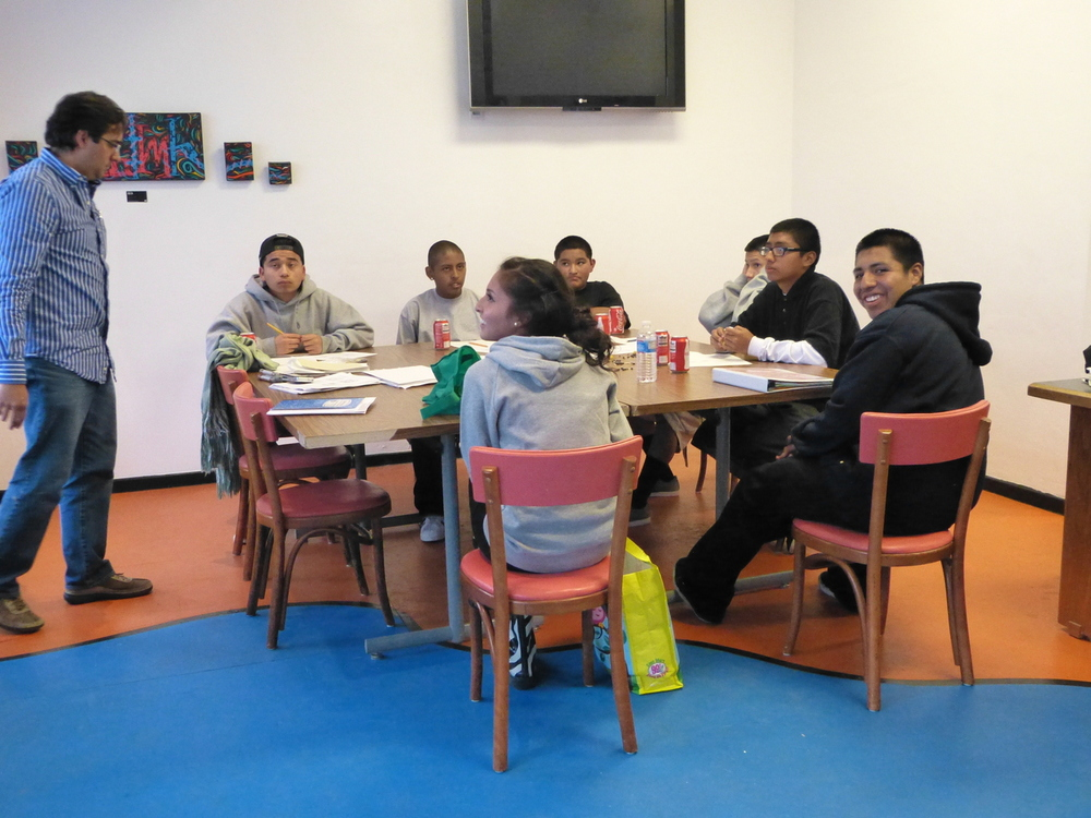 On Fridays, the Youth Interactive center is home to lessons in the Mayan language, led by Andrea Medina. Participants include Christian, Andy, Carlos, Edgar, Alejandro, Orlando, José, Nestor, and Cecilia.