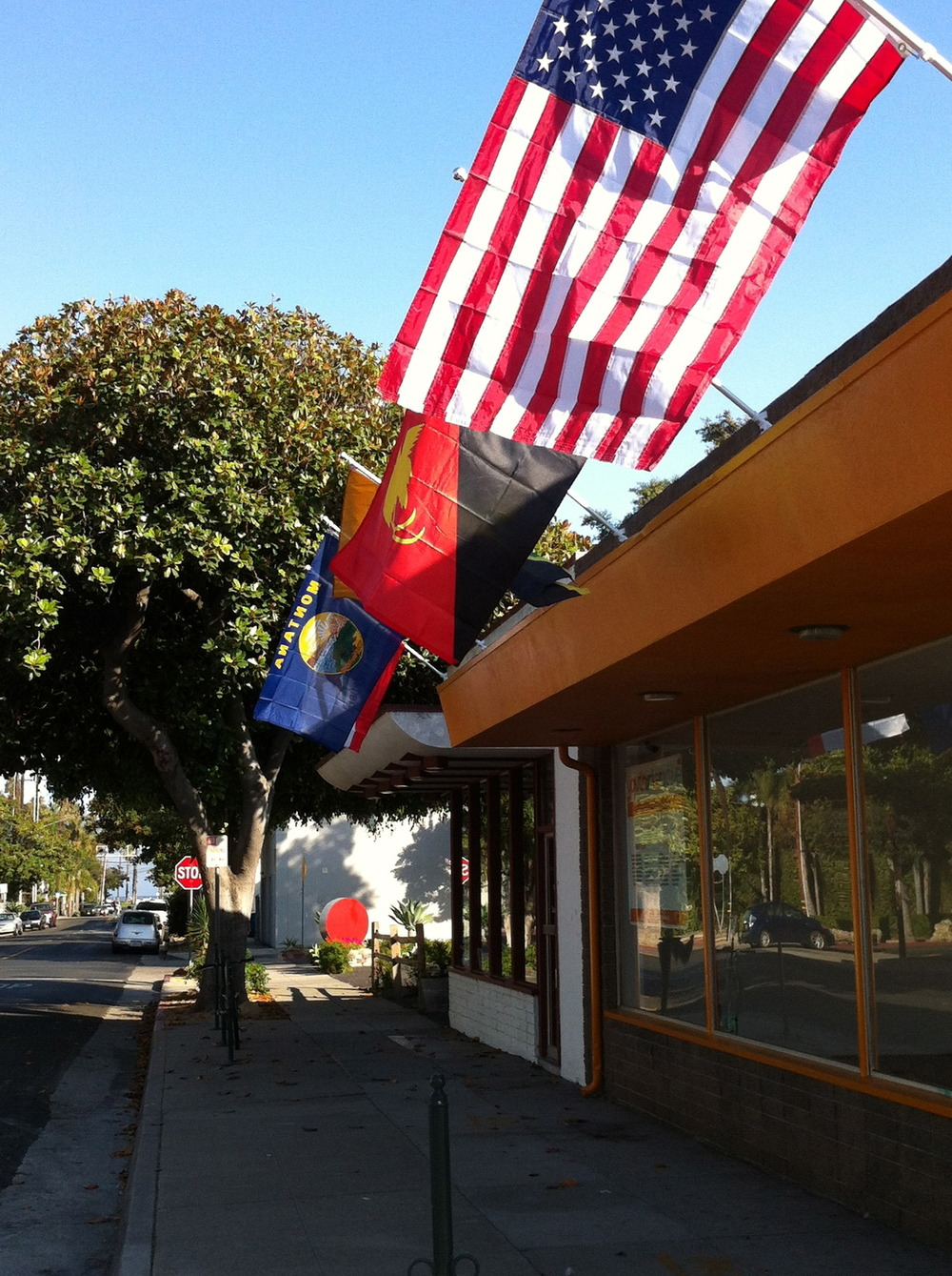A tough morning faced with vandalism in the Funk Zone!!!! Not only did the USA and California flag get stolen with their polls on Funk day weekend, but now someone has flicked white paint on all the other flags….why do that?!!
